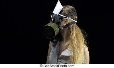 Young nurse girl in gas mask - Footage of young nurse on...