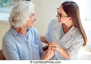 Young nurse helping senior patient