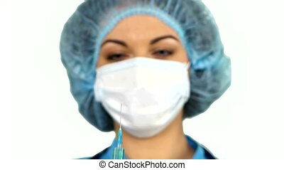 Young nurse in mask with syringe on white background