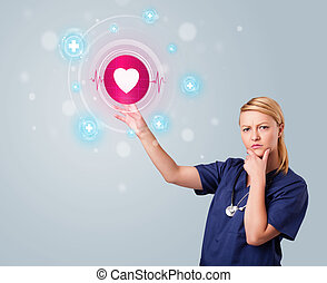 Young nurse pressing modern medical type of buttons - Young...