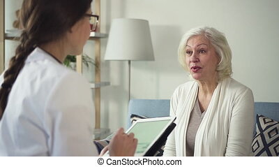 Young nurse visit sick mature women at her house