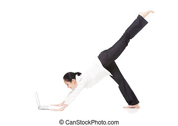 Young office woman in yoga pose holding laptop on white...