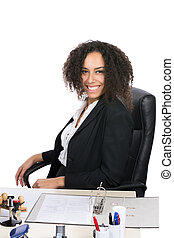 Young office worker sits at the desk