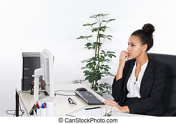 Young office worker sits thoughtfully at the desk