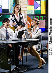 Young office workers in colorful meeting room