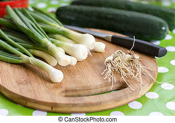 Young onions on the cutting board