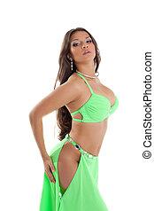 Young oriental dancer in green suit