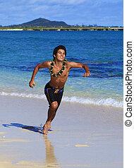 man running on a hawaii beach