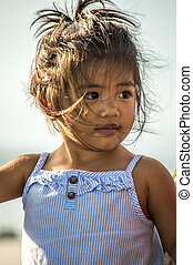 Young Pacific Islander girl - A little girl with wind tossed...