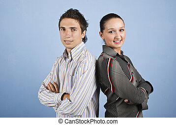Young pair of business people smiling