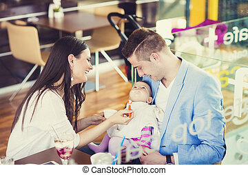 Young parents with their daughter
