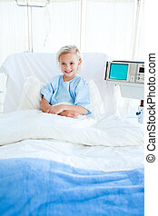 Young patient sitting on a hospital bed