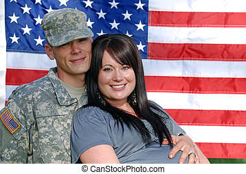 Young Patriotic Couple - Young couple in front of the United...