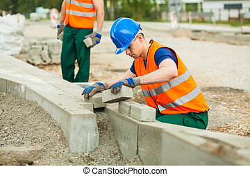 Young paver at work