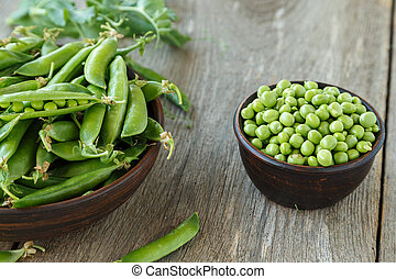 young peas on a wooden table