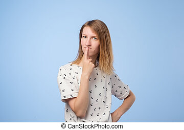 young pensive caucasian woman over white background