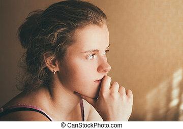 Young pensive Teen Girl