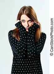 Young pensive woman looking at camera