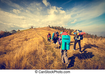 Young people are hiking in mountains