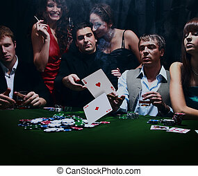 young people are playing poker in a casino.