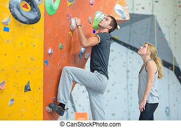 Young people at indoor climbing wall