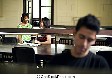 Young people at school, students studying in college library
