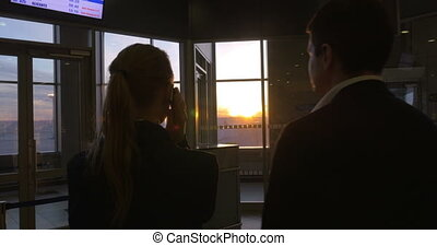 Young people at the airport at sunset
