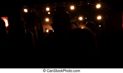 Young people at the rep rock concert, slow-motion shot