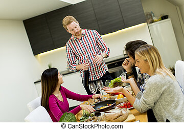 Young people at the table in kitchen