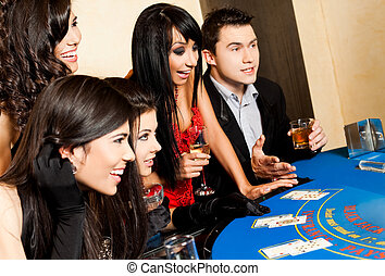 Young people black jack casino - Group of young happy people...