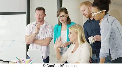 Young people brainstorming in office