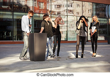 Young people calling on the cell phones