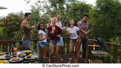 Young People Dancing While Cooking Barbecue Happy Group...