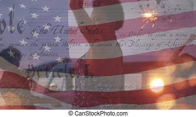 Animation of U.S. flag waving with U.S. Constitution text rolling over multi-ethnic group of friends holding sparklers. United States of America flag and holiday concept digital composition