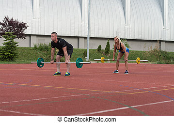 Young People Doing Bent Over Barbell Row Exercise