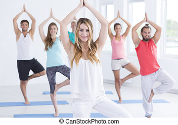 Young people doing yoga practice for healthy body and mind