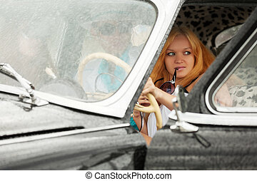 Young people driving retro car