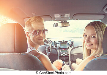 Young people enjoying a roadtrip in the car