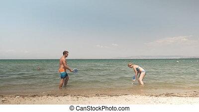 Young people enjoying tennis in the sea