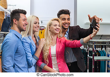 Young People Fashion Shop Taking Selfie Photo Shopping, Happy Smiling Friends Choosing Clothes