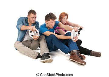 Young people gaming - Three young friends ar gaming with the...