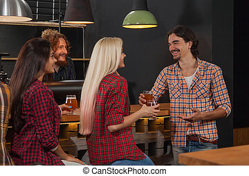 Young People Group In Bar, Friends Sitting At Wooden Counter Pub, Drink Beer