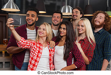 Young People Group In Bar, Happy Smiling Friends Taking Selfie Photo On Cell Smart Phone Beer Pub