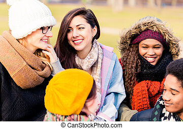 Young people having a good time together outdoors