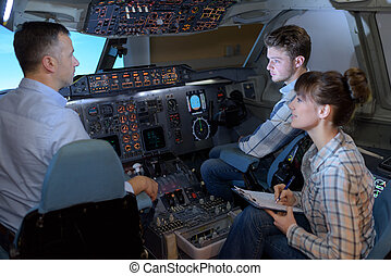 Young people in aircraft cockpit