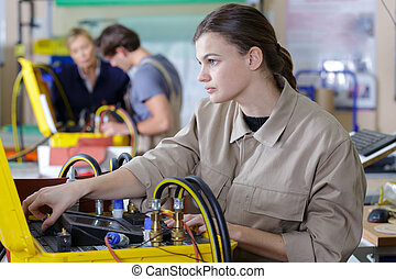 young people in technical vocational training with teacher