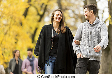 Young people in the autumn park