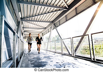 Young people in the city running together. - Beautiful young...