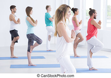 Young people in yoga club