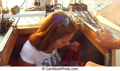 Young people is resting on the sailing yacht. in slowmotion....